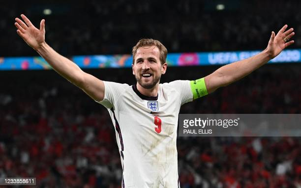 England's forward Harry Kane celebrates after winning during the UEFA EURO 2020 semi-final football match between England and Denmark at Wembley...