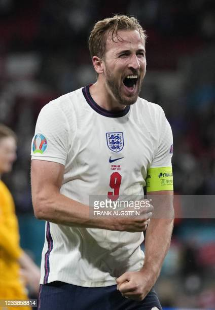 England's forward Harry Kane celebrates after winning the UEFA EURO 2020 semi-final football match between England and Denmark at Wembley Stadium in...