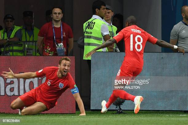 TOPSHOT England's forward Harry Kane celebrates his second goal with England's defender Ashley Young during the Russia 2018 World Cup Group G...