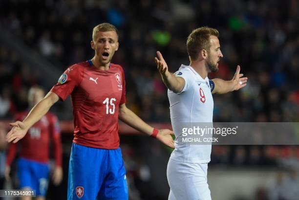England's forward Harry Kane celebrates scoring the opening goal next to Czech Republic's midfielder Tomas Soucek during the UEFA Euro 2020 qualifier...