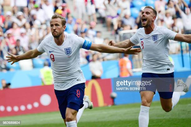 England's forward Harry Kane celebrates with England's midfielder Jordan Henderson after scoring a penalty during the Russia 2018 World Cup Group G...