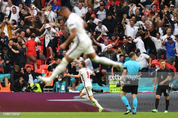 England's forward Harry Kane celebrates with the fans after scoring the second goal during the UEFA EURO 2020 round of 16 football match between...