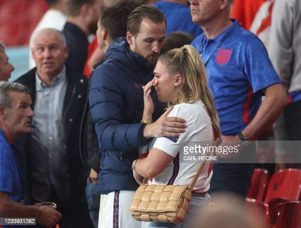England's forward Harry Kane consoles his wife Katie after Italy won the UEFA EURO 2020 final football match between Italy and England at the Wembley...