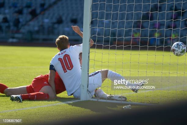 England's forward Harry Kane ends up in Iceland's goalkeeper Hannes Halldorsson's goal with the ball to score a disallowed goal during the UEFA...