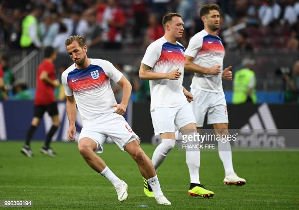 England's forward Harry Kane , England's defender Phil Jones and England's defender Gary Cahill warm up ahead of the Russia 2018 World Cup semi-final...