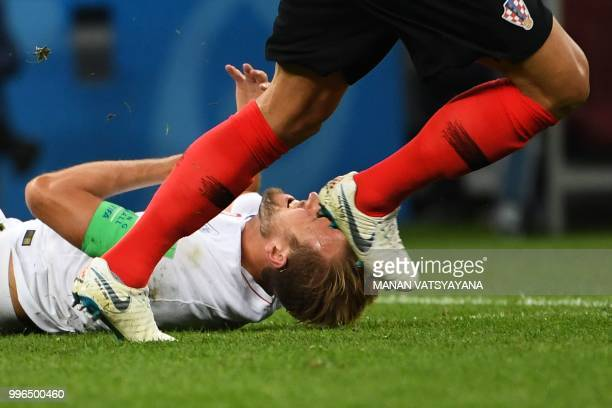 TOPSHOT England's forward Harry Kane falls after a challenge during the Russia 2018 World Cup semifinal football match between Croatia and England at...