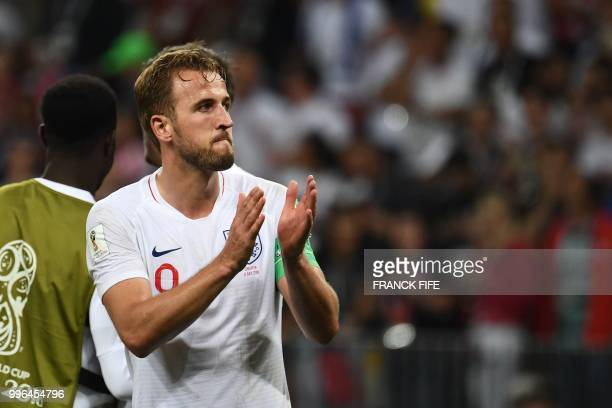 England's forward Harry Kane greets supporters after their loss in the Russia 2018 World Cup semifinal football match between Croatia and England at...