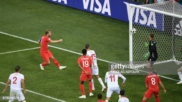 England's forward Harry Kane heads the ball and scores his second goal during the Russia 2018 World Cup Group G football match between Tunisia and...