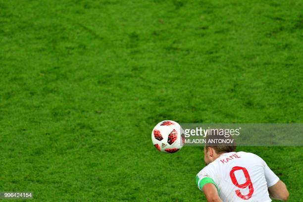 England's forward Harry Kane heads the ball during the Russia 2018 World Cup semifinal football match between Croatia and England at the Luzhniki...