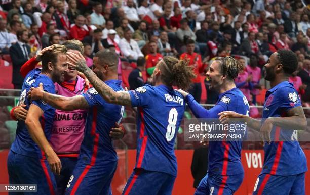 England's forward Harry Kane is celebrated by teammates after scoring the 0-1 goal during the FIFA World Cup Qatar 2022 qualification Group I...