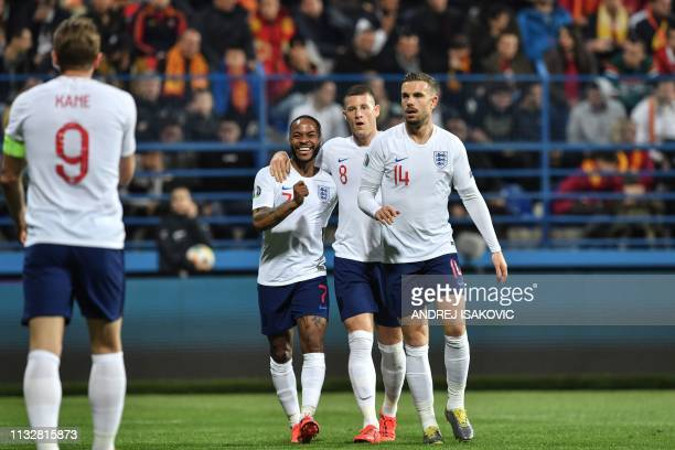 England's forward Harry Kane is congrulated by England's forward Raheem Sterling England's midfielder Ross Barkley and England's midfielder Jordan...