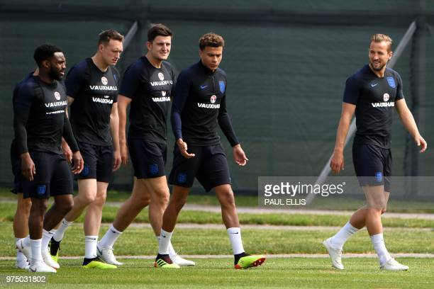 England's forward Harry Kane leads his team out for a training session in Repino on June 15 ahead of the team's Russia 2018 World Cup Group G...