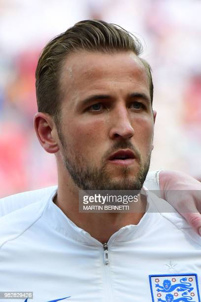 England's forward Harry Kane listens to the national anthems before the Russia 2018 World Cup Group G football match between England and Panama at...