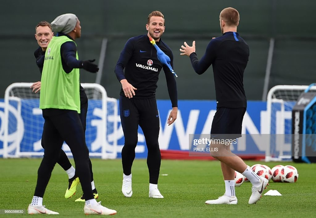 England's forward Harry Kane (C) looks at a rooster toy being thrown around as he takes part in a training session in Repino on July 10, 2018 ahead of their semi-final match against Croatia during the Russia 2018 World Cup football tournament.