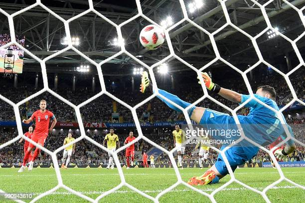 TOPSHOT England's forward Harry Kane scores a goal after shooting a penalty kick during the Russia 2018 World Cup round of 16 football match between...