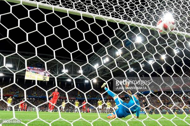 England's forward Harry Kane scores a goal after shooting a penalty kick during the Russia 2018 World Cup round of 16 football match between Colombia...