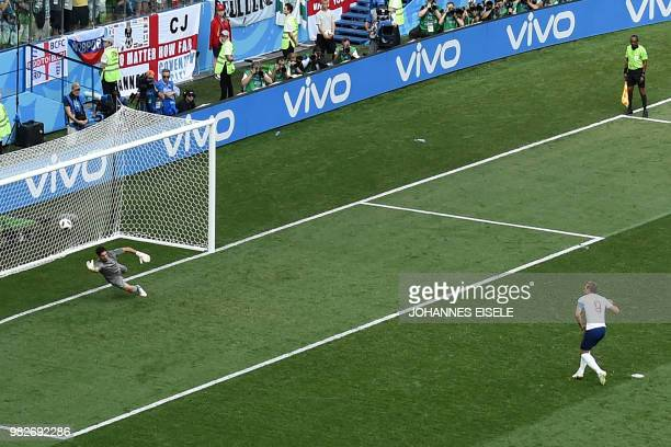 TOPSHOT England's forward Harry Kane scores a penalty goal during the Russia 2018 World Cup Group G football match between England and Panama at the...