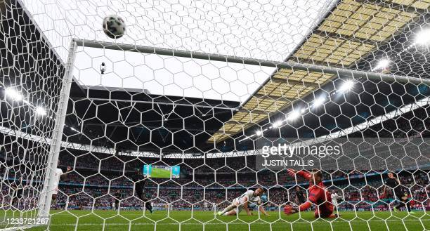 England's forward Harry Kane scores England's second goal during the UEFA EURO 2020 round of 16 football match between England and Germany at Wembley...