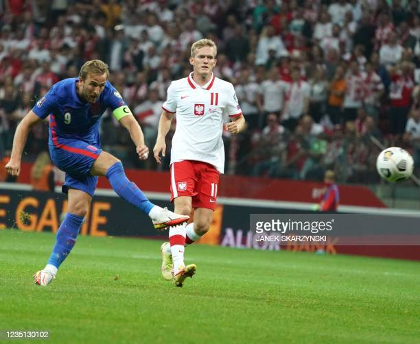 England's forward Harry Kane scores the 0-1 goal during the FIFA World Cup Qatar 2022 qualification Group I football match between Poland and England...