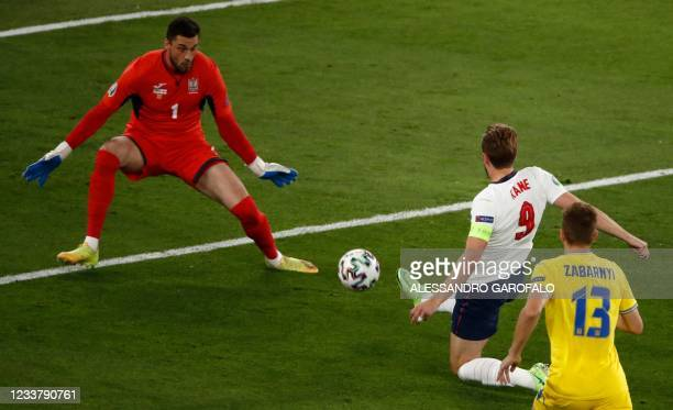 England's forward Harry Kane scores the opening goal during the UEFA EURO 2020 quarter-final football match between Ukraine and England at the...