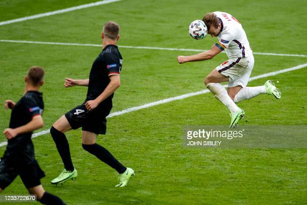 England's forward Harry Kane scores the second goal during the UEFA EURO 2020 round of 16 football match between England and Germany at Wembley...