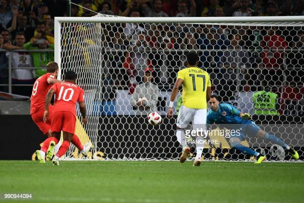 England's forward Harry Kane shoots a penalty kick and scores a goal past Colombia's goalkeeper David Ospina during the Russia 2018 World Cup round...