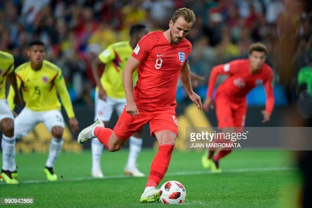 TOPSHOT England's forward Harry Kane shoots a penalty kick to score a goal during the Russia 2018 World Cup round of 16 football match between...