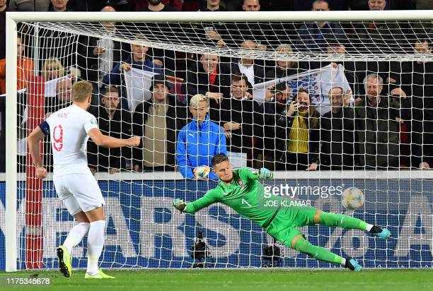 England's forward Harry Kane shoots a penalty to score the 01 against Czech Republic's goalkeeper Tomas Vaclik during the UEFA Euro 2020 qualifier...