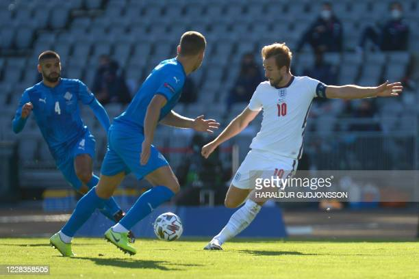 England's forward Harry Kane shoots the ball during the UEFA Nations League football match between Iceland v England on September 5, 2020 in...