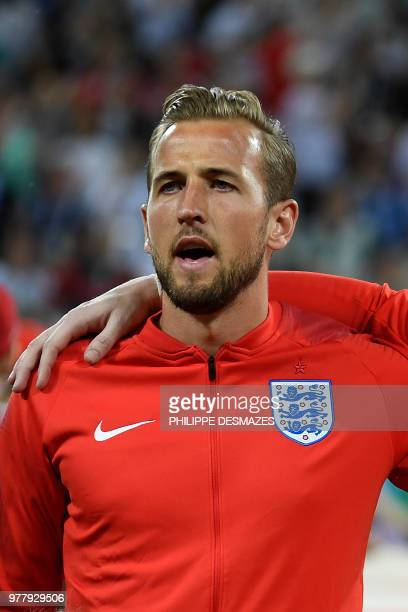 England's forward Harry Kane sings the national anthem before the Russia 2018 World Cup Group G football match between Tunisia and England at the...