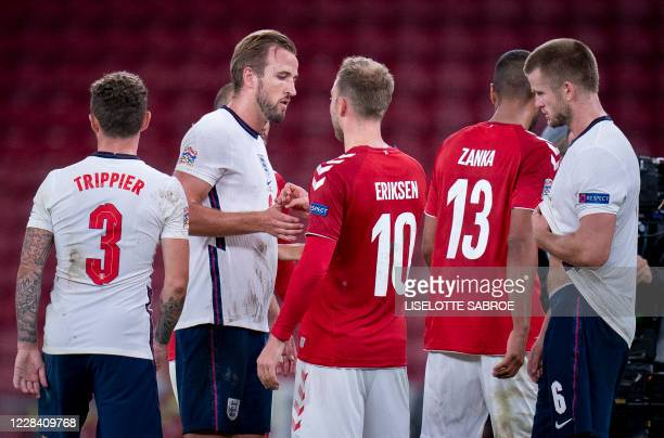 England's forward Harry Kane speaks with Denmark's midfielder Christian Eriksen after the UEFA Nations League football match between Denmark and...