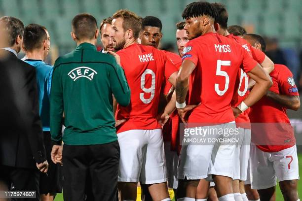 England's forward Harry Kane speaks with the referees during a temporary interruption of the Euro 2020 Group A football qualification match between...