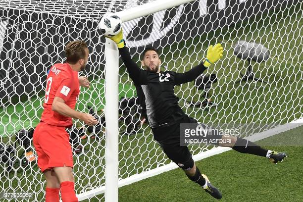 TOPSHOT England's forward Harry Kane vies for the ball with Tunisia's goalkeeper Mouez Hassen during the Russia 2018 World Cup Group G football match...