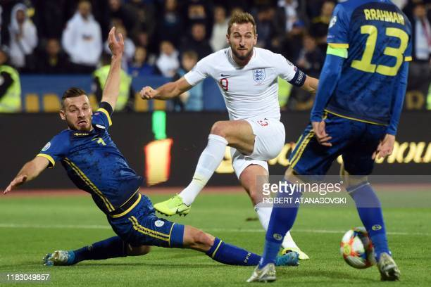 England's forward Harry Kane vies with Kosovo's defender Fidan Aliti during the UEFA Euro 2020 qualifying Group A football match between Kosovo and...