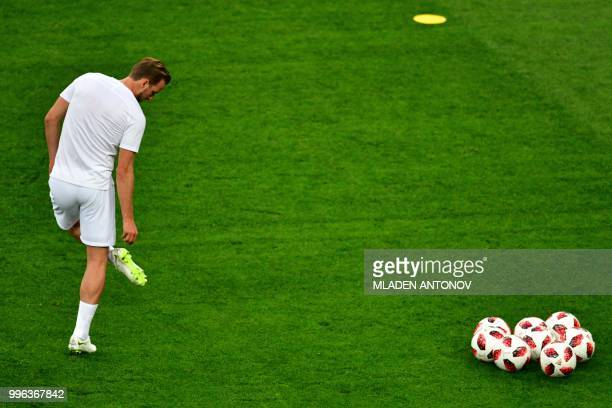England's forward Harry Kane warms up prior to the Russia 2018 World Cup semifinal football match between Croatia and England at the Luzhniki Stadium...