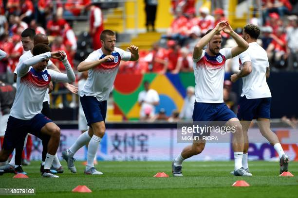 England's forward Harry Kane warms up with teammates before the UEFA Nations League third place playoff football match between Switzerland and...