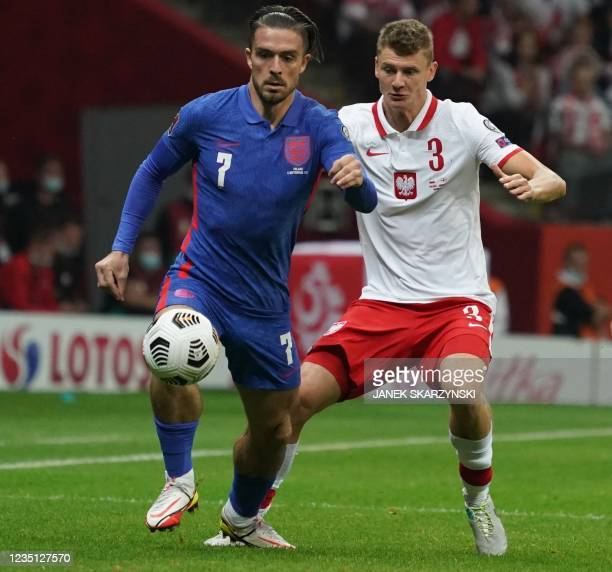 England's forward Jack Grealish and Poland's midfielder Pawel Dawidowicz vie for a ball during the FIFA World Cup Qatar 2022 qualification Group I...