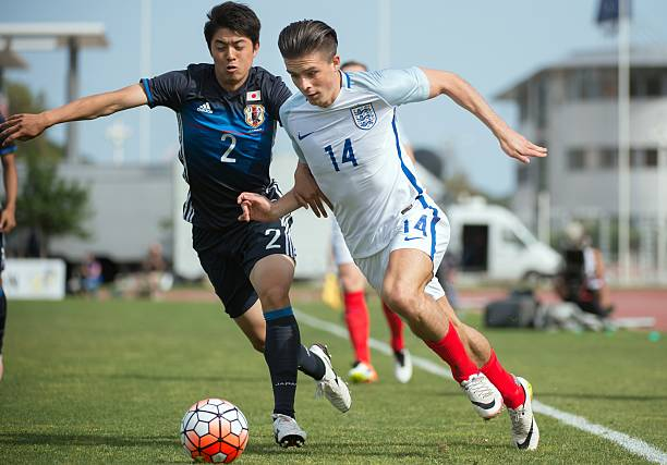 England's forward Jack Grealish vies with Japan's defender Sai Van Vermeskerken during the 'Festival International Espoirs' Under 21 football match...