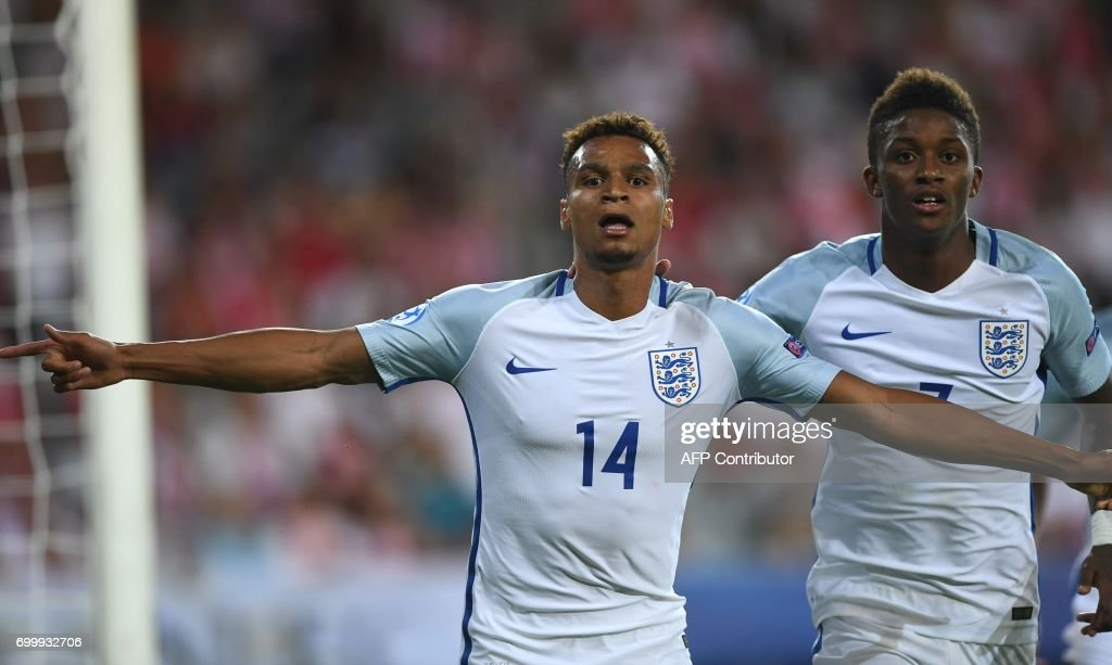 England's forward Jacob Murphy (L) celebrate scoring with his teammate midfielder Demarai Gray during the UEFA U-21 European Championship Group A football match England v Poland in Kielce, Poland on June 22, 2017. /