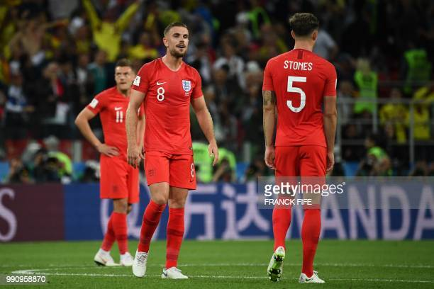 England's forward Jamie Vardy England's midfielder Jordan Henderson and England's defender John Stones reacts after Colombia's defender Yerry Mina...