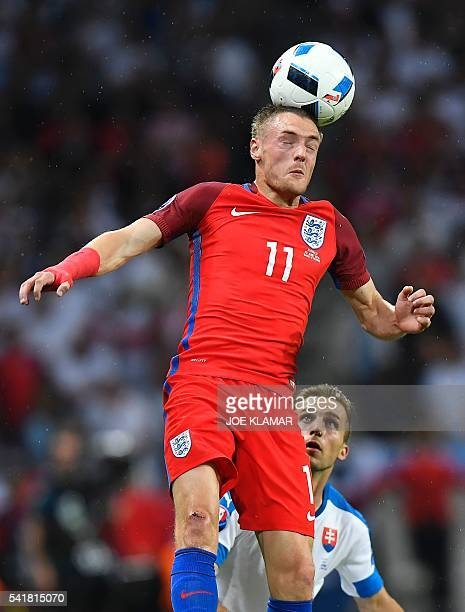 England's forward Jamie Vardy heads the ball during the Euro 2016 group B football match between Slovakia and England at the GeoffroyGuichard stadium...