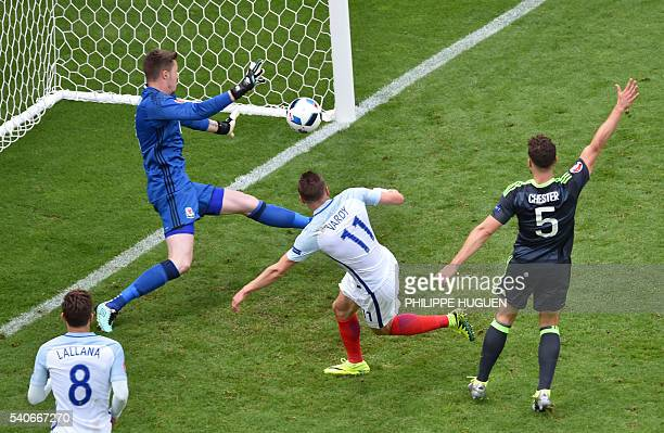 TOPSHOT England's forward Jamie Vardy scores the 11 against Wales' goalkeeper Wayne Hennessey during the Euro 2016 group B football match between...