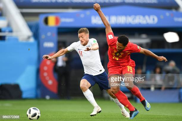 England's forward Jamie Vardy vies with Belgium's midfielder Moussa Dembele during the Russia 2018 World Cup Group G football match between England...