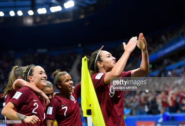 England's forward Jodie Taylor celebrates after scoring the opening goal during the France 2019 Women's World Cup Group D football match between...