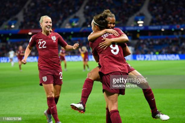 England's forward Jodie Taylor celebrates with England's forward Nikita Parris and England's forward Beth Mead after scoring the opening goal during...