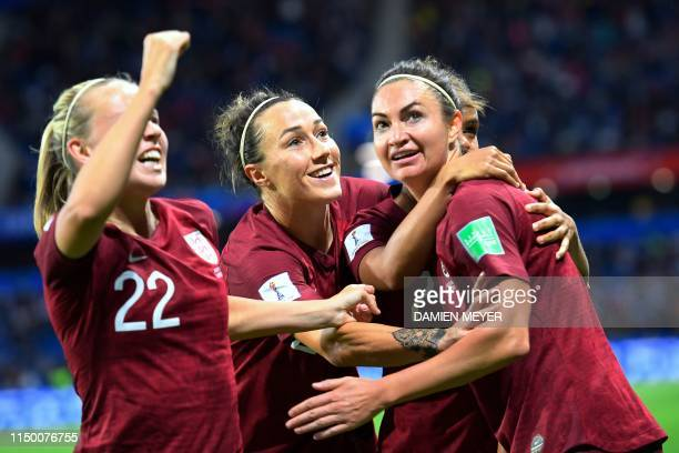 England's forward Jodie Taylor celebrates with teammates after scoring the opening goal during the France 2019 Women's World Cup Group D football...
