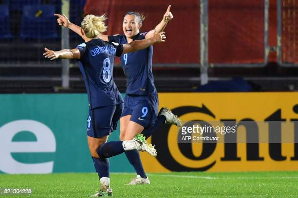 England's forward Jodie Taylor celebrates with teammates after scoring a goal during the UEFA Womens Euro 2017 football tournament match between...