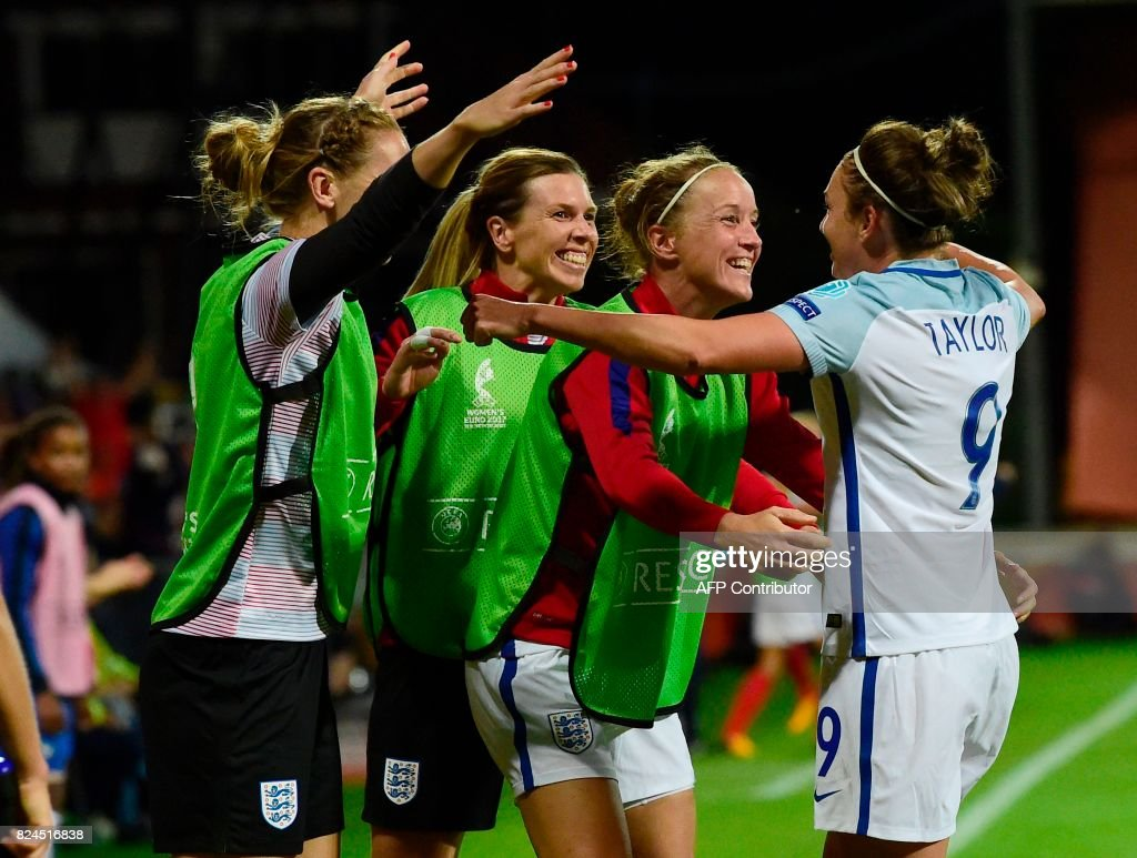England's forward Jodie Taylor (R) celebrates with teammates after scoring a goal during the UEFA Women's Euro 2017 tournament quarter-final football match between England and France at Stadium De Adelaarshorst in Deventer, on July 30, 2017. /