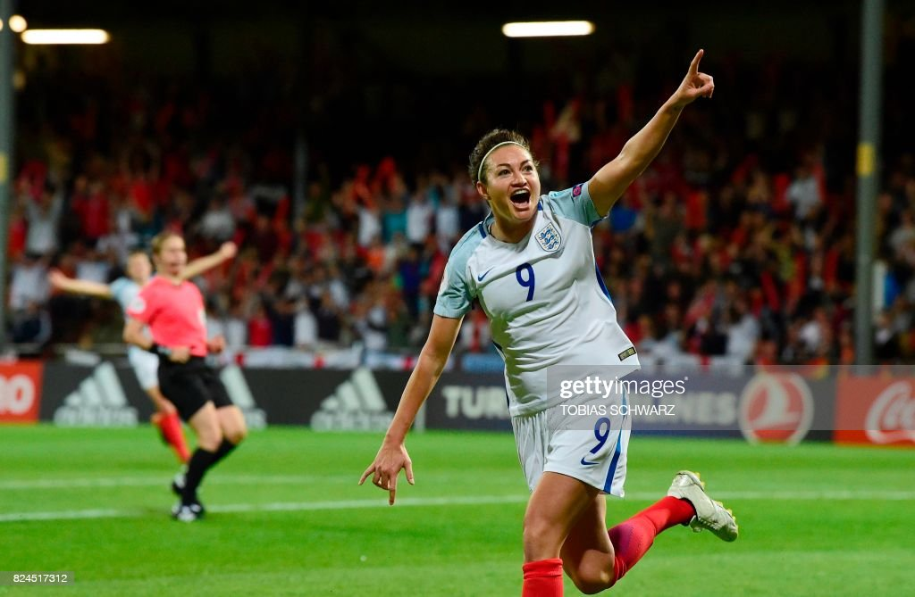 England's forward Jodie Taylor reacts after scoring a goal during the UEFA Women's Euro 2017 tournament quarter-final football match between England and France at Stadium De Adelaarshorst in Deventer, on July 30, 2017. /