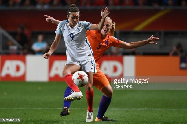 England's forward Jodie Taylor vies for the ball with Netherlands' defender Stephanie van der Gragt during the UEFA Womens Euro 2017 football...